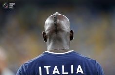 Italy's Balotelli takes part in a warm up session before their Euro 2012 quarter-final soccer match against England at the Olympic Stadium in Kiev. DARREN STAPLES/REUTERS