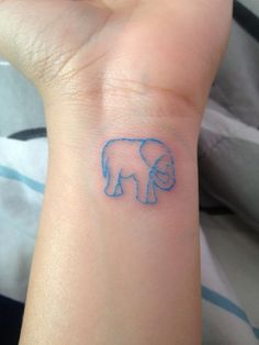 elephant tattoo on my ankle LOVE THE BLUE!