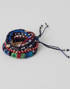:PACK OF 8 FABRIC, BEAD AND METAL BRACELETS