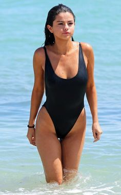 Selena Gomez in a retro style high side one piece swimsuit