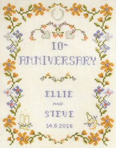 Amber Wedding Anniversary cross stitch kit for any anniversary; with vibrant border in spring colours dressed with beads; hearts,champagne flutes & horseshoe
