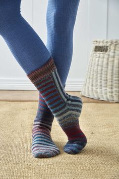 """I've always been fascinated by construction and the various ways one can arrive at something that resembles a """"normal"""" sock. This design plays with knitting in different directions in a combination of working in rows and rounds. Thankfully, there are no long seams or grafting because the parts are joined as they're worked. The stripes highlight the construction method, but you could achieve a similar effect by omitting the stripes and working the entire sock in a long gradient or…"""