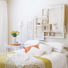 headboards: if I could part with any of my beautiful wooden frames to experiment with whitewashing such as the ones above, it's a cute display idea (maybe more apt for a store).