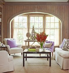 In designer Louis Brook's Rowayton, walls and built-in bookcases are paneled with cerused oak.