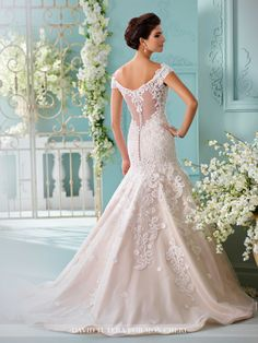 David Tutera for Mon Cheri - 216254 Sialia - Off-the-shoulder tulle over soft satin fit and flare gown with hand-beaded embroidered lace appliqués, illusion and lace cap sleeves feature delicate necklace-like draped beading, lace motifs adorn bodice with dropped waist, illusion and lace back with covered button closures, beaded tulle skirt with cascading appliqués, horsehair hem, chapel length train.Sizes: 0 - 20, 18W - 26WColors: Ivory/Champagne, Ivory, White