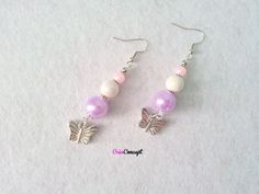 boucles d 'oreilles papillon argenté et perles coloris rose, blanc, mauve par Créaconcept :  http://www.alittlemarket.com/boutique/creaconcept-899765.html