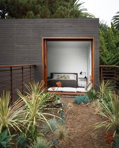 A guest bedroom with furniture from Room & Board overlooks the bridge above the dining courtyard. The homes landscape architecture is by Ventura Californiabased Jack Kiesel. #bedroom #green #outdoor #bungalow #succulents #dwell  Photo by @coralvz Architecture by Sebastian Mariscal by dwellmagazine