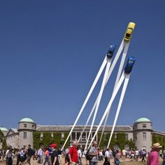 This streamlined sculpture by designer Gerry Judah features three Porsche 911s soaring up into the sky like rockets.