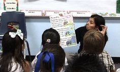 Yesenia Del Angel, a kindergarten dual-language teacher at Regency Place Elementary School, leads her class in singing a song in Spanish. (Express-News 2008 file photo)