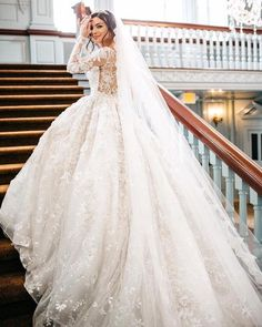 Chic long-sleeve floral detailed ballgown wedding dress; Featured Dress: YSA Makino