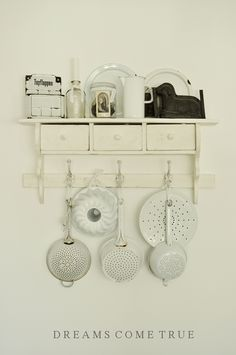 I love the shelves, the hooks and the colanders. I love it all.