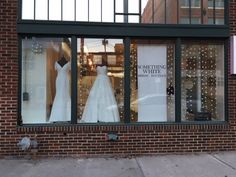 Winter window display at Something White Bridal Boutique.