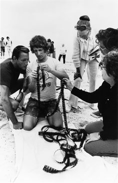 Director Steven Spielberg, (with Roy Scheider), checking his dailies on the set of Jaws (1977)