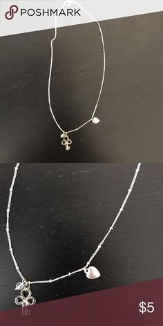 Silver charm necklace Cute silver necklace with a few charms. Simple and cute. Bundles and save! Jewelry Necklaces
