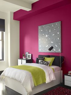 A bold hot pink can warm up any room, this wall is Royal Flush 2076-20 by Benjamin Moore.