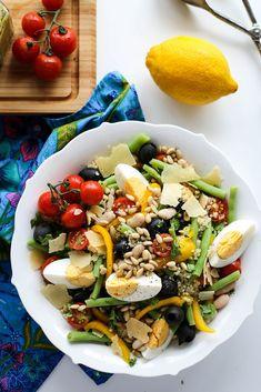 A light salad with quinoa, beans, and a pesto dressing