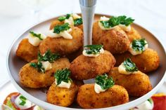 These tempting tapas bites are crisp with a creamy cheese and ham centre.