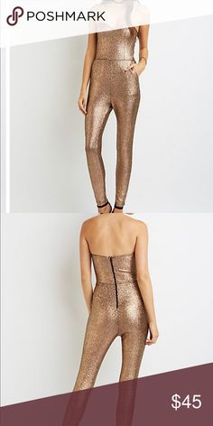 """Shimmery gold Jumpsuit Sz S This metallic knit jumpsuit is party ready in a strapless silhouette and body-hugging fit! The sweetheart bodice tops the high-rise pants that taper into skinny legs below. Slant pockets add a stylish, and functional finish at the sides. No tags   Zipper closure at back Bust is lined Product Model Size: Model is 5'11"""" tall Product Fit: Model is wearing size small. Size small measure 46"""" from top to hem. Size small has a 27"""" inseam and a 22.25"""" front rise…"""