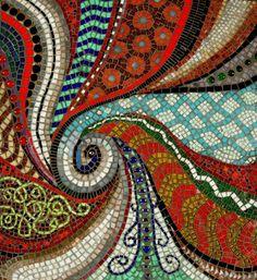 Wonderful array of mosaic artwork! Idea for backsplash behind the range.