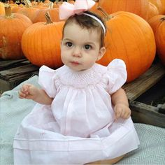 The cutest pumpkin in the patch!  @cristiwrose Nicole is sweet as pumpkin pie in her Feltman Brothers Bishop dress with Rosettes! This lovely dress comes in pink or blue in sizes 3m-4t!  http://feltmanbrothers.com/bishop-dress-with-rosettes/