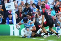 Argentina's Tomas Lavanini crashes over the line to score the opening try for his side.  RWC 2015.