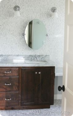 Wood stained cabinets, marble top