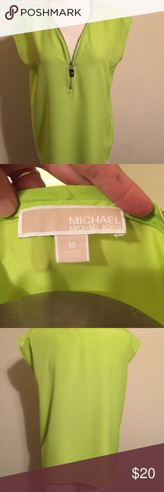 Michael Kors Zipper Blouse Great Michael Kors lime green blouse! The zipper gives it such a special touch! Looks cute zipped up or down. Can be worn alone or under a jacket. Lightweight, flows beautifully, a must have! 👍👍 Enjoy!! Michael Kors Tops Blouses