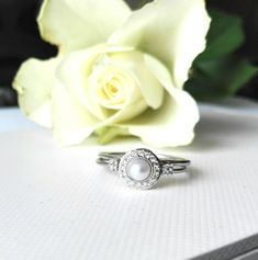 Halo pearl engagement ring with matching wedding band handcrafted in 14k white gold. #haloring #engagement #pearlengagement #wedding set #etsy