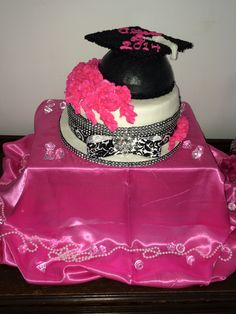 Graduation cake I made for my twin sister. She personally picked out the ribbon and rhinestones for her cake.
