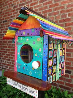 Lisa Hay. Mineral Point, WI. Our little library was constructed by Roland Sardeson and hand-painted by Lisa Hay. It sits outside the candy store High Street Sweets and is filled with children's books.