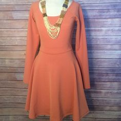 SALE 25% OFF ALL BUNDLES NWOT peach dress with long sleeves and open lace cross back! Have questions on the size? Ask! I'm happy to provide all measurements! NO TRADES/PAYPAL! Fast shipping! No swaps! Dresses