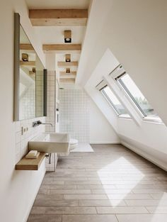 Simple bathroom designed to highlight attic shape and architecture