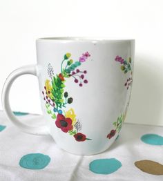 Draw on a blank coffee mug with sharpies and bake in a cold oven at 350 for 30 minutes. I've done this before with black sharpies, and I wanna try colour! NEVER PUT IN THE DISHWASHER! Made that mistake