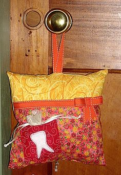 tooth fairy pillow - I just love the idea of hanging it on the door...no sneaking a little tooth out from under the pillow.