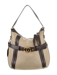 Tan canvas Gucci Running hobo bag with brown leather trim throughout, gold-tone hardware, detachable shoulder strap, brown woven lining, three pockets at interior walls; one zip pocket, two slit pockets and zip closure at top. Includes dust bag. Shop Gucci new and pre-owned luxury bags at The RealReal.
