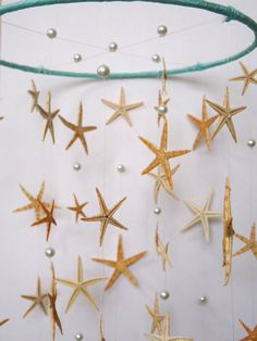 Love this star fish mobile! Must try this! I can paint paint white starfish and sea horses and make my own mobile. I am going to paint them blue and coral!