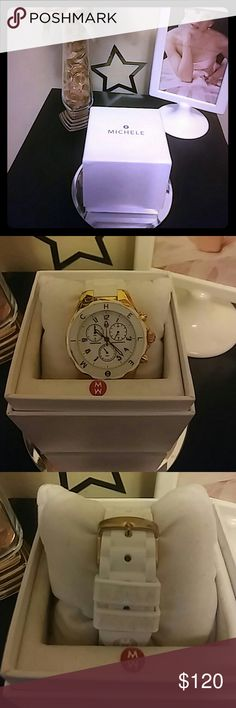 White Michele watch Beautiful White and gold Michele watch. It doesn't have a battery and it also have a small crack on the bezel which isn't noticeable.  It comes with a watch pillow and the original box i am open to TRADES as well but it must be near or around the asking price. Take ur time and look through my closet i have alot of nice things and willing to price differently if u dont try to low ball me. Happy poshing once again im open to                                  TRADE…
