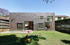 Renovation of a bungalow. The rear elevation with the new brick addition and irregular windows is a nice contrast to the decorative restoration of the existing street facade. House Boone Murray by Tribe Studio Architects