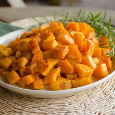 Paleo Roasted Butternut Squash with Garlic and Rosemary. This roasted butternut squash recipe is incredibly simple. The hands-on prep takes just a few minutes, and the oven does all the work for you. http://cookeatpaleo.com/roasted-butternut-squash/  #glutenfree #dairyfree