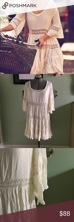 Free People Daisy Love Lace Bell Sleeve Dress Free People daisy lace Dress in sand or cream color. Size medium. Beautiful sheer Dress that comes with a Slip. Size medium. Festive and unique flowing shape with slight high low style. Worn by Taylor swift I believe! Worn once. Let me know if you have any questions! Free People Dresses