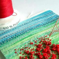 Handstitching beads and french knots to create a field of poppies.