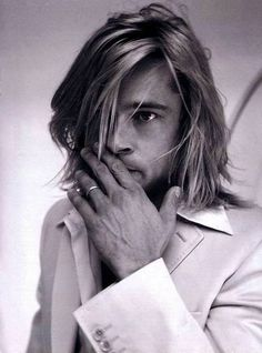 Brad Pitt, modeling a delightfully tousled long men's cut- he keeps it manly by not over-grooming his face: his brows are still full, he's got the stubble, and of course, he's wearing a good suit for structure.