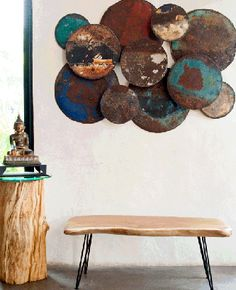 oil drum wall hanging with natural exotic furniture