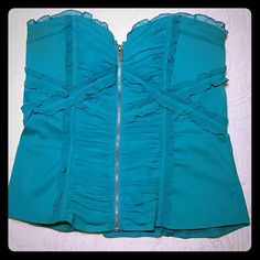 Teal bebe corset This super cute Teal  bebe corset needs to be dry cleaned. I have only worn it once but has been sitting in closet. No stains and in great condition! bebe Tops