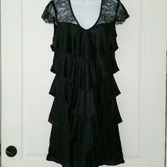 """💞SALE💞 Bcbgmaxazria Black Cocktail Dress Gorgeous Bcbgmaxazria Black Ruffle & Lace Cocktail Dress. Brand New with Tags 100% Polyester fully lined with 92% Polyester 8% Spandex 35"""" from top of shoulder to bottom 17"""" from armpit to armpit. BCBGMaxAzria Dresses"""