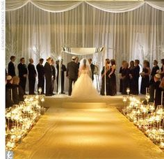 gold aisle runner with candles
