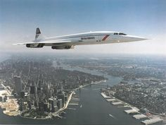 British Airways Concorde flying over lower Manhattan NYC. Three hours to Paris!