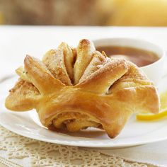 Delicious served at Thanksgiving dinner or for Christmas brunch; making slits in the dough before baking creates a playful fantail shape and a sneak peek of the scrumptious cinnamon filling inside.