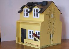 Front of Evie's doll house, hand painted by Penny