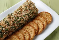 "Salmon Spread: 1 can salmon 8 oz cream cheese, softened 1 tsp lemon juice 2 tsp finely chopped onion 1 tsp horseradish 1/4 tsp salt 1/2 c finely chopped pecans 3 T dried parsley. Drain salmon & flake into bowl. Remove any skin/bones. Add cream cheese, lemon juice, onion, horseradish & salt. Blend & chill several hours. Combine pecans and parsley. Shape salmon mix into 8x2"" log. Roll in pecan mix. Chill."